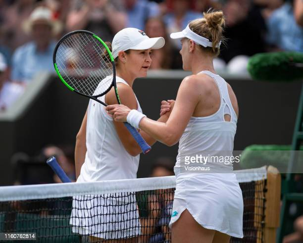 Alison Riske of USA and Ashleigh Barty of Australia shake hands at the net during Day Seven of The Championships Wimbledon 2019 at All England Lawn...