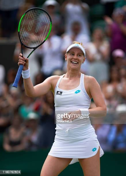 Alison Riske of USA celebrates beating Ashleigh Barty of Australia during Day Seven of The Championships Wimbledon 2019 at All England Lawn Tennis...
