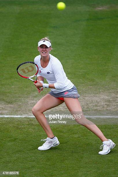 Alison Riske of USA in action against Eugenie Bouchard of Canada during the Aegon International day three at DevEugenie Bouchard of Canada in action...