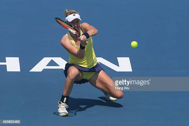 Alison Riske of USA returns a shot during her match against Shilin Xu of China during day one of the 2014 Dongfeng Motor Wuhan Open at Wuhan Guanggu...