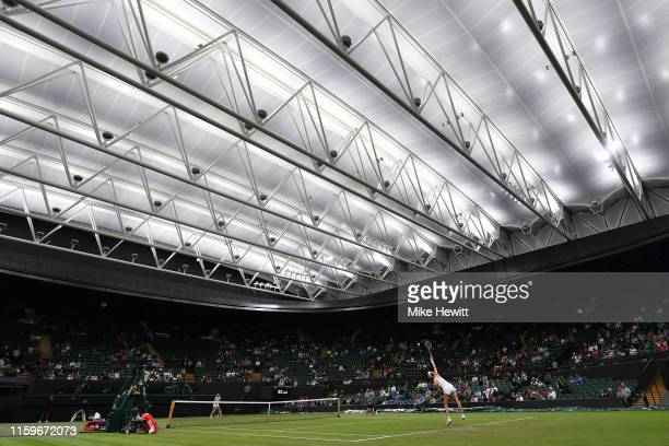 Alison Riske of USA serves under the new Court 1 roof during her 1st round match against Donna Vekic of Croatia on Day 2 of The Championships -...