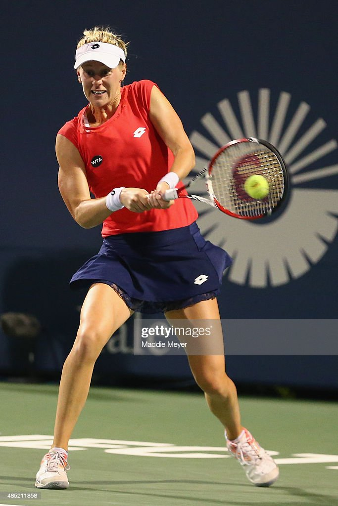 Alison Riske returns a backhand to Caroline Wozniaki of Denmark during day 2 of the Connecticut Open at Connecticut Tennis Center at Yale on August 25, 2015 in New Haven, Connecticut.