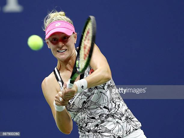 Alison Riske returns a shot to Madison Keys during the first set on Day One of the 2016 US Open at the USTA Billie Jean King National Tennis Center...