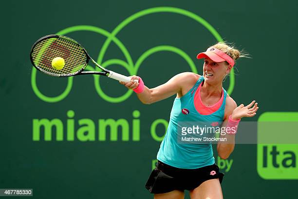 Alison Riske returns a shot to Svetlana Kuznetsova of Russia during day 5 of the Miami Open Presented by Itau at Crandon Park Tennis Center on March...