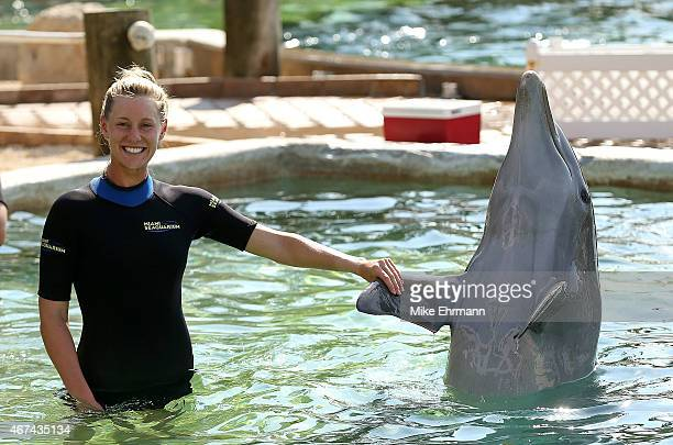 Alison Riske swims with the dolphins at the Miami Seaquarium ahead of the Miami Open at Crandon Park Tennis Center on March 24 2015 in Key Biscayne...
