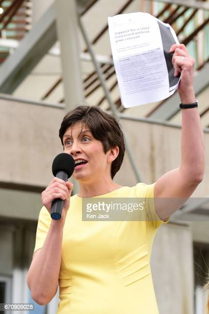 Alison Thewliss MP holds up a copy of the eightpage form affected women are expected to fill in as she leads the protest outside the Scottish...
