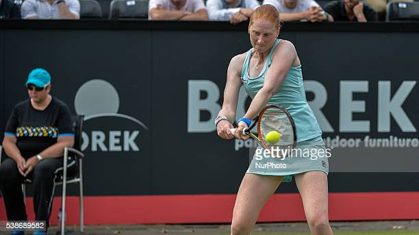 Alison van Uytvanck from Belgium backhands a return to Belinda Bencic from Switzerland on Tuesday 7th of June 2016 at the Ricoh Open Grass Court...