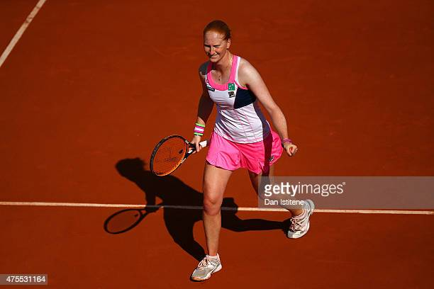 Alison Van Uytvanck of Belgium celebrates match point in her women's singles match against Andreea Mitu of Romania on day nine of the 2015 French...