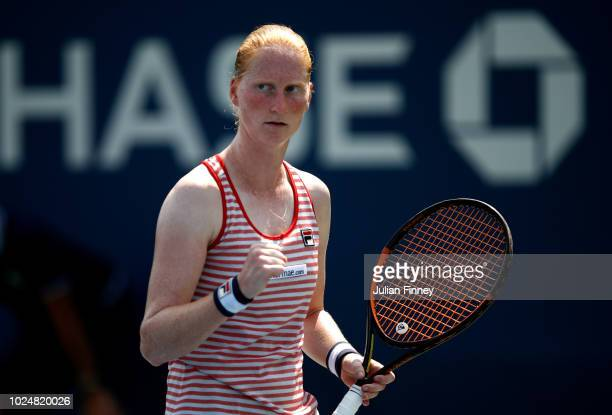 Alison Van Uytvanck of Belgium celebrates the point during her women's singles first round match against Lesia Tsurenko of Ukraine on Day Two of the...