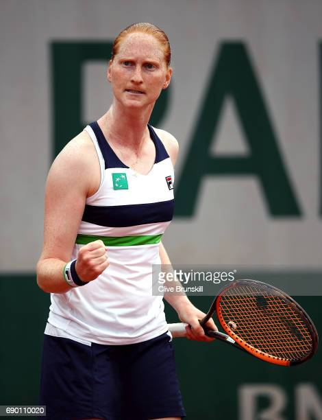 Alison Van Uytvanck of Belgium celebrates winning a point during the first round match against Naomi Osaka of Japan on day three of the 2017 French...