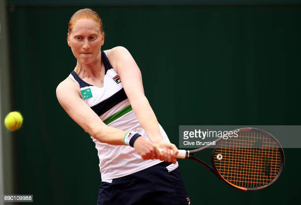 Alison Van Uytvanck of Belgium hits a backhand during the first round match against Naomi Osaka of Japan on day three of the 2017 French Open at...