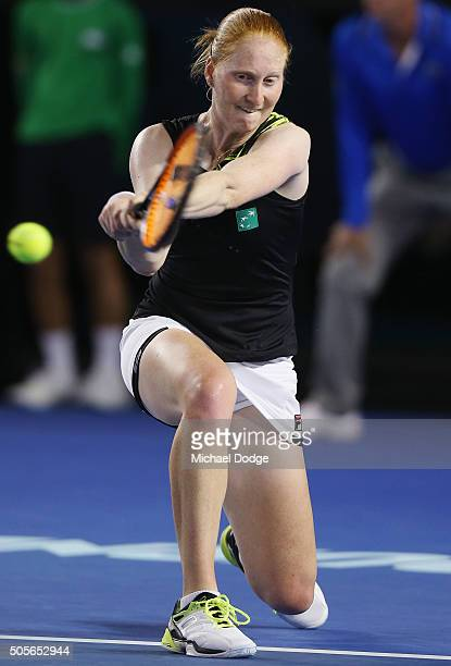 Alison Van Uytvanck of Belgium hitting a backhand failed to win a game in her first round match against Victoria Azarenka of Belarus during day two...