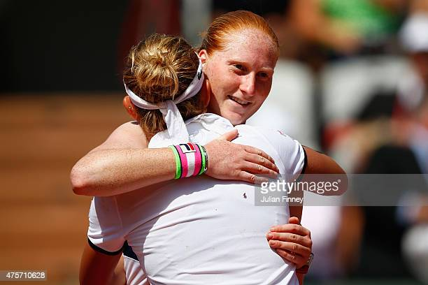 Alison Van Uytvanck of Belgium hugs Timea Bacsinszky of Switzerland at the net after defeat in their Women's quarter final match on day eleven of the...