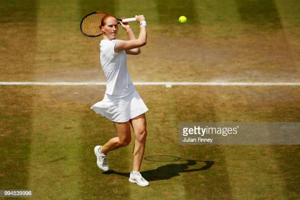 Alison Van Uytvanck of Belgium plays a backhand against Daria Kasatkina of Russia during their Ladies' Singles fourth round match on day seven of the...