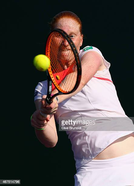 Alison Van Uytvanck of Belgium plays a backhand against Magdalena Rybarkova of Slovakia in their first round match during the Miami Open at Crandon...
