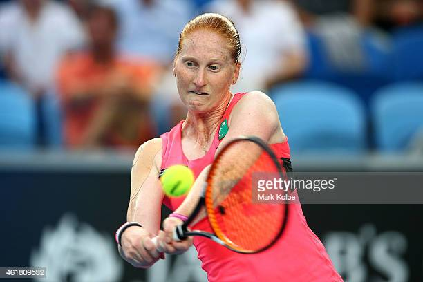 Alison Van Uytvanck of Belgium plays a backhand in her first round match against Serena Williams of the United States during day two of the 2015...