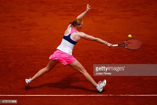 Alison Van Uytvanck of Belgium plays a backhand in her Women's quarter final match against Timea Bacsinszky of Switzerland on day eleven of the 2015...