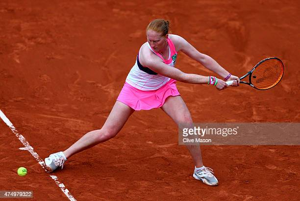 Alison Van Uytvanck of Belgium plays a backhand in her Women's Singles match against Zarina Diyas of Kazakhstan on day five of the 2015 French Open...