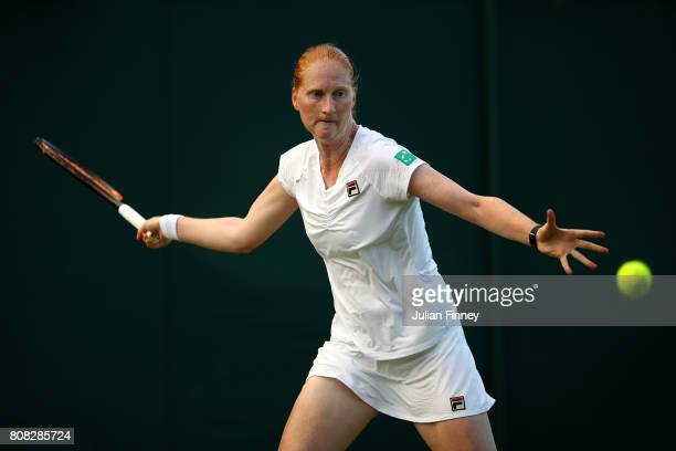 Alison Van Uytvanck of Belgium plays a forehand during the Ladies Singles first round match against Ekaterina Makarova of Germany on day two of the...