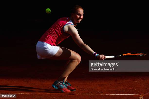 Alison Van Uytvanck of Belgium returns a backhand in her match against Samantha Stosur of Australia during day two of the Internazionali BNL d'Italia...
