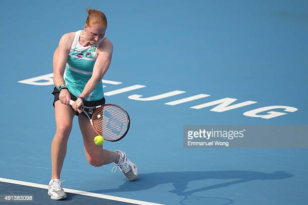 Alison Van Uytvanck of Belgium returns a ball against Roberta Vinci of Italy during the day three of the 2015 China Open at the China National Tennis...