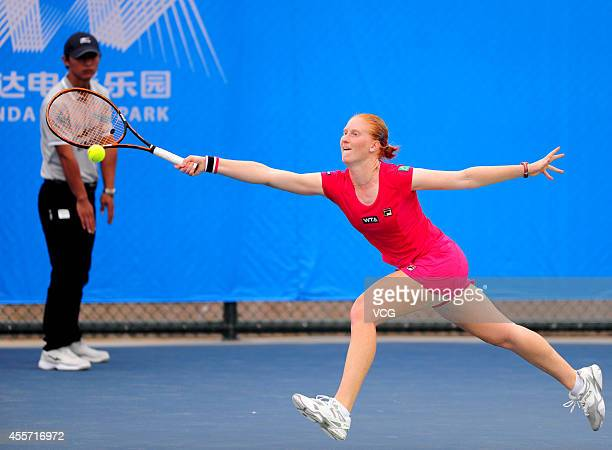 Alison Van Uytvanck of Belgium returns a ball in the qualifying match against Kristina Mladenovic of France prior to the start of 2014 WTA Wuhan Open...