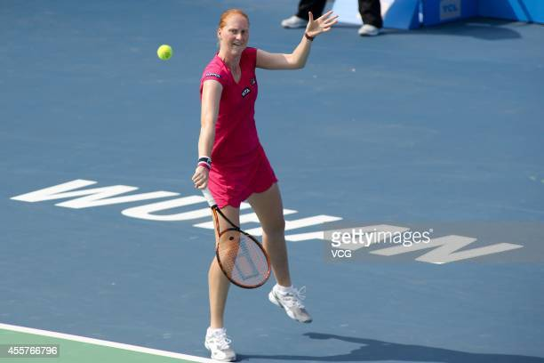 Alison Van Uytvanck of Belgium returns a ball in the qualifying match against Francesca Schiavone of Italy prior to the start of 2014 WTA Wuhan Open...