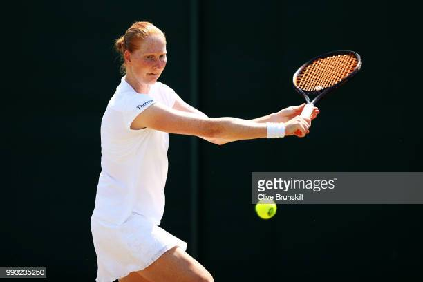 Alison Van Uytvanck of Belgium returns a shot against Anett Kontaveit of Estonia during their Ladies' Singles third round match on day six of the...