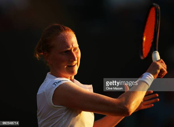 Alison Van Uytvanck of Belgium returns a shot against Garbine Muguruza of Spain during their Ladies' Singles second round match on day four of the...