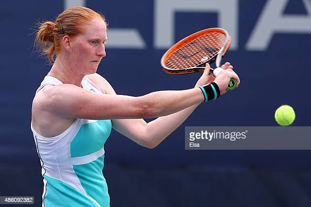 Alison Van Uytvanck of Belgium returns a shot against Jessica Pegula of the United States on Day One of the 2015 US Open at the USTA Billie Jean King...