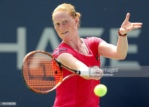 Alison Van Uytvanck of Belgium returns a shot against Varvara Lepchenko of the United States on Day Two of the 2014 US Open at the USTA Billie Jean...