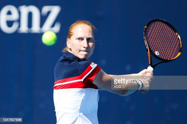 Alison Van Uytvanck of Belgium returns a shot in the Women's Singles first round match against Katerina Siniakova of the Czech Republic on day three...