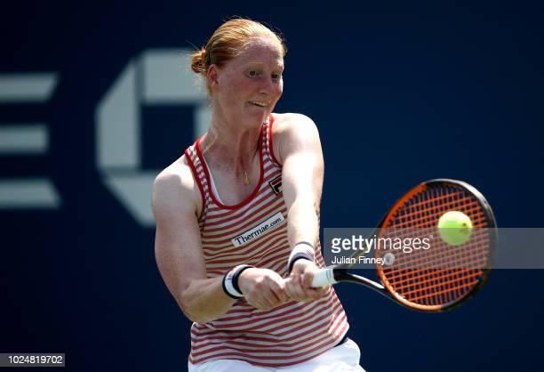 Alison Van Uytvanck of Belgium returns the ball during her women's singles first round match against Lesia Tsurenko of Ukraine on Day Two of the 2018...