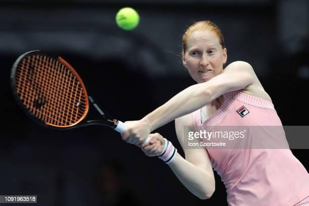 Alison Van Uytvanck of Belgium returns the ball during the St Petersburg Ladies Trophy tennis tournament match on January 31 at Sibur Arena in St...