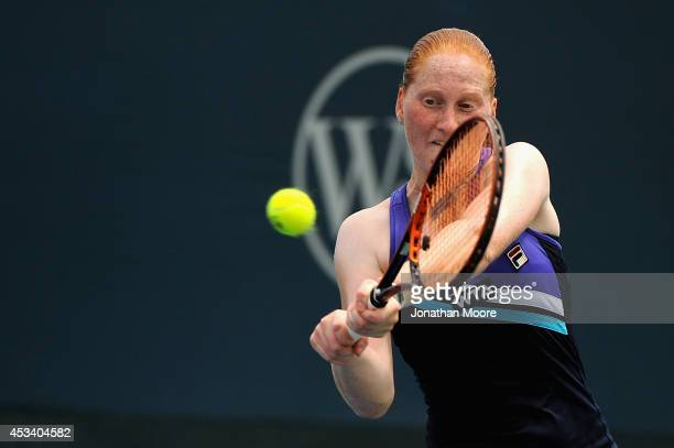 Alison Van Uytvanck of Belgium returns to Yanina Wickmayer of Belgium during a match on day 1 of the Western and Southern Open on August 9 2014 in...