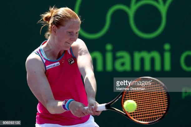 Alison Van Uytvanck of Belgium rteturns a shot to Agnieszka Radwanska of Poland during Day 4 of the Miami Open at the Crandon Park Tennis Center on...