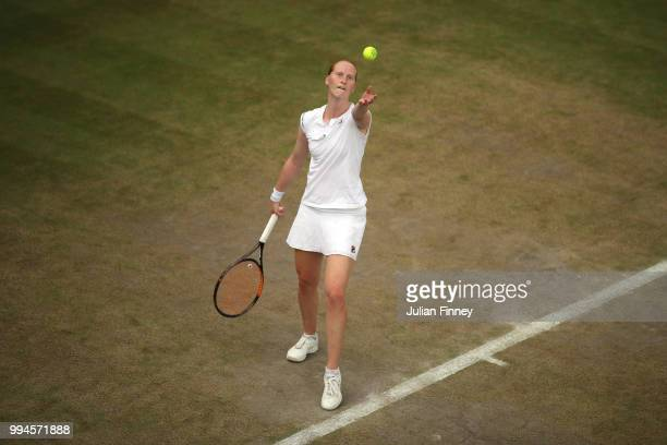 Alison Van Uytvanck of Belgium serves against Daria Kasatkina of Russia during their Ladies' Singles fourth round match on day seven of the Wimbledon...