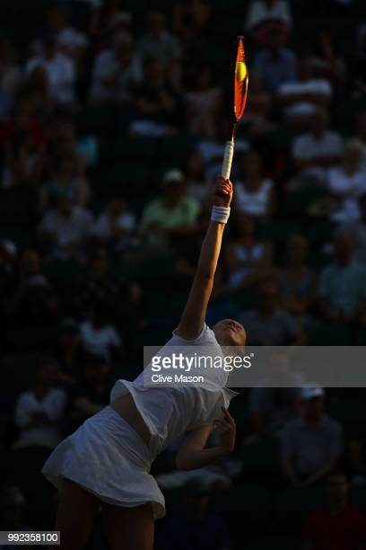 Alison Van Uytvanck of Belgium serves against Garbine Muguruza of Spain during their Ladies' Singles second round match on day four of the Wimbledon...