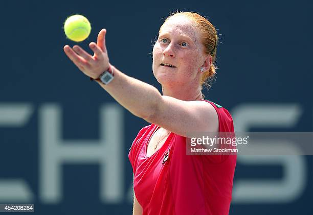Alison Van Uytvanck of Belgium serves against Varvara Lepchenko of the United States on Day Two of the 2014 US Open at the USTA Billie Jean King...