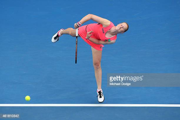 Alison Van Uytvanck of Belgium serves in her first round match against Serena Williams of the United States during day two of the 2015 Australian...
