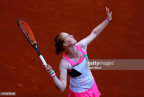 Alison Van Uytvanck of Belgium serves in her Women's Singles match against Zarina Diyas of Kazakhstan on day five of the 2015 French Open at Roland...