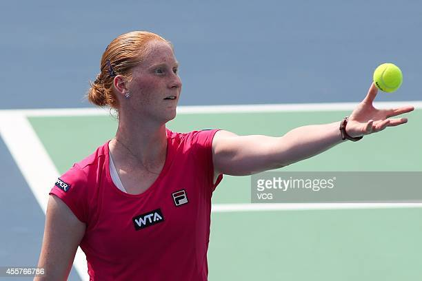 Alison Van Uytvanck of Belgium serves in the qualifying match against Francesca Schiavone of Italy prior to the start of 2014 WTA Wuhan Open at...