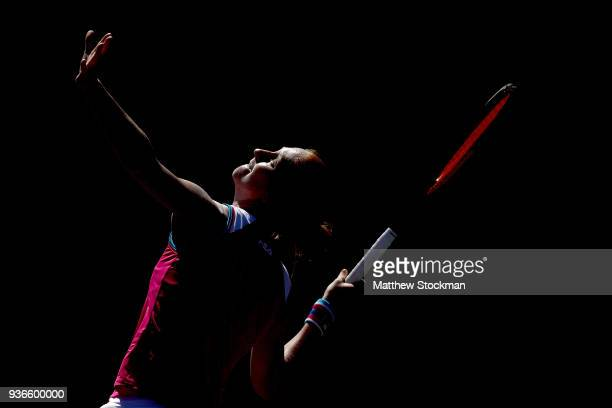 Alison Van Uytvanck of Belgium serves to Agnieszka Radwanska of Poland during Day 4 of the Miami Open at the Crandon Park Tennis Center on March 22...