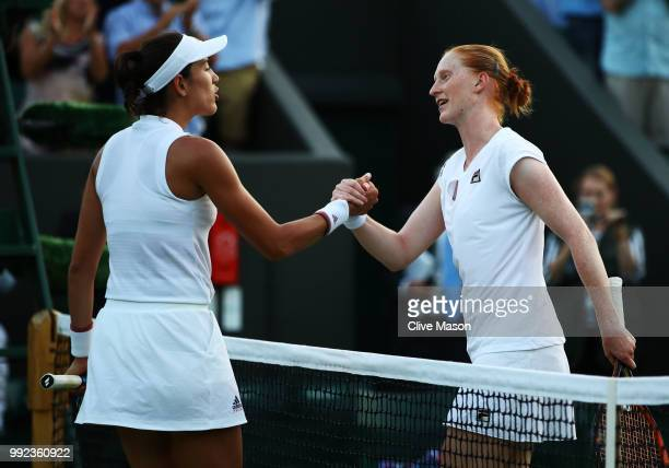 Alison Van Uytvanck of Belgium shakes hands with Garbine Muguruza of Spain in their Ladies' Singles second round match on day four of the Wimbledon...