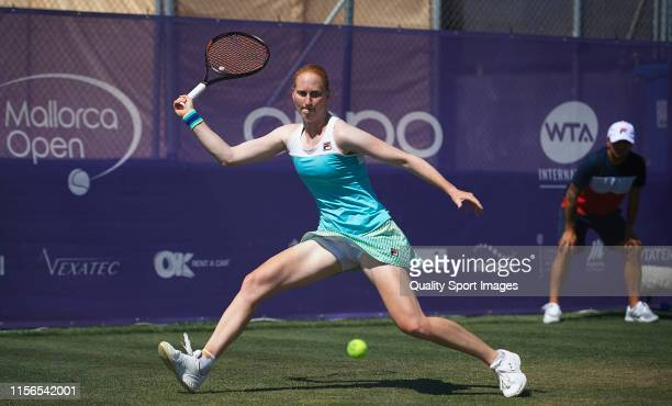 Alison Van Uytvanck of The Netherlands in action during her ladies singles first round match against Katerina Siniakova of The Czech Republic during...