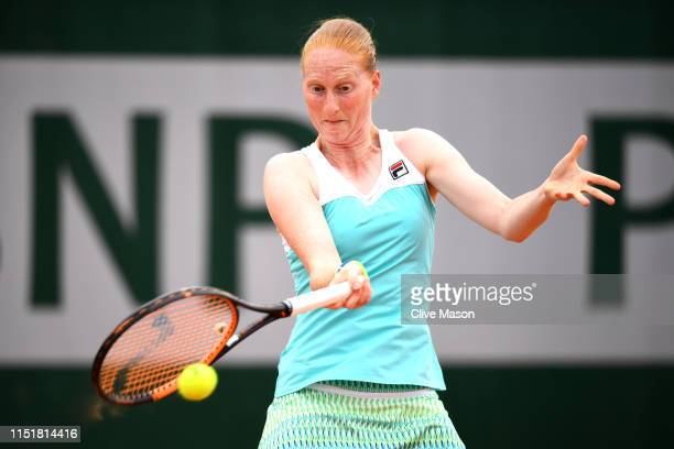 Alison Van Uytvanck of The Netherlands plays a forehand in her ladies singles first round match against Sara Sorribes Tormo of Spain during Day one...