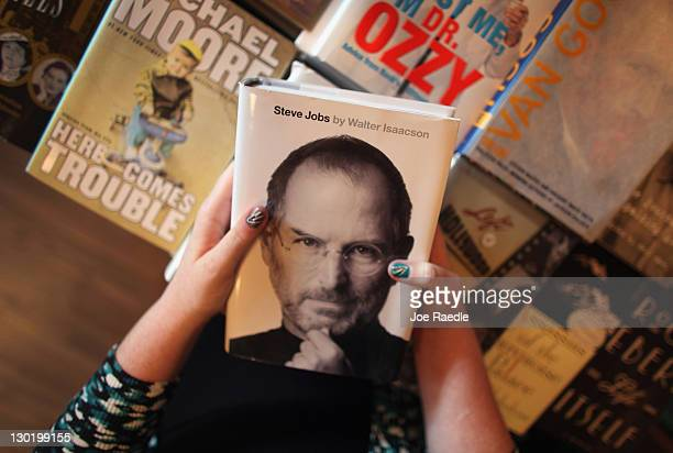 Alison Weiss looks at a copy of the newly released biography of Apple cofounder and former CEO Steve Jobs at the Books Books store on October 24 2011...