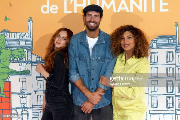 """Alison Wheeler, Nawell Madani, Tom Leeb attend the photocall for the premiere of """"8 rue de l'Humanité"""" on September 24, 2021 in Vitry-en-Artois near..."""