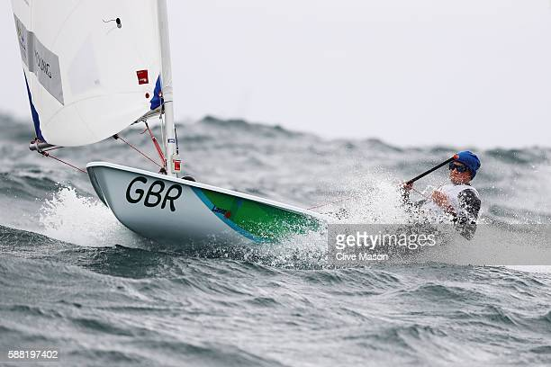Alison Young of Great Britain during the weather delayed Women's Laser Radials Class races on Day 5 of the Rio 2016 Olympic Games at the Marina da...