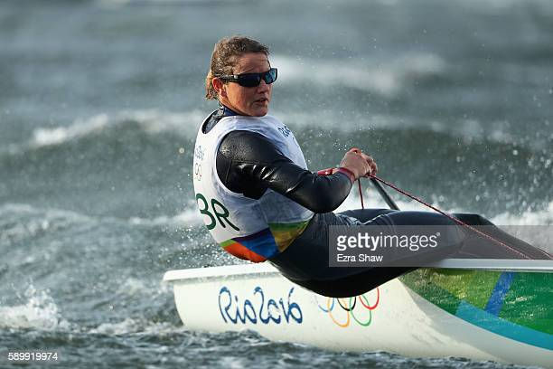 Alison Young of Great Britain sails in the rough conditions for the Laser Radial class on Day 10 of the Rio 2016 Olympic Games at the Marina da...